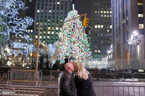 Spectators enjoy the celebration during 81st Annual Rockefeller Center Christmas Tree Lighting Ceremony at Rockefeller Center on December 4 2013 in...