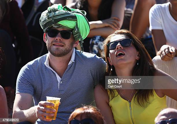 Spectators enjoy the hot weather during day two of the Wimbledon Lawn Tennis Championships at the All England Lawn Tennis and Croquet Club on June 30...