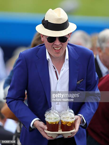 Spectators enjoy trays of Pimms during day four of The Aegon Championships at The Queens Club on June 16 2016 in London England