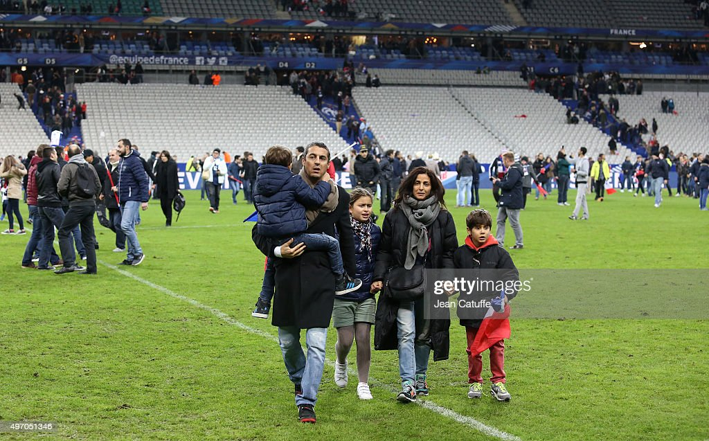 Spectators enter the pitch to be in a safe place after learning of the attacks near the stadium and across Paris after the international friendly...