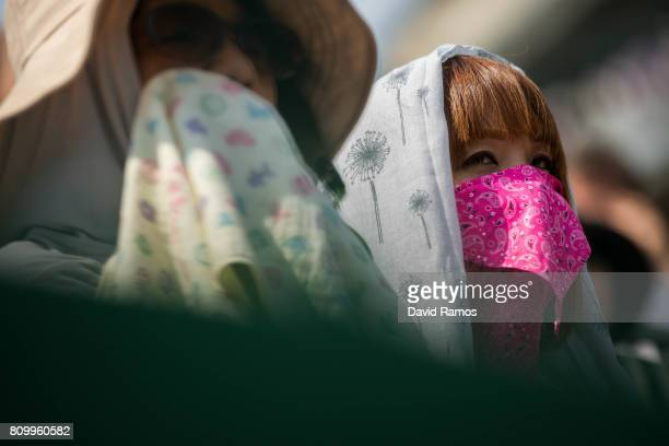 Spectators follow the action during the Gentlemen's Singles second round match between Yuichi Sugita of Japan and Adrian Mannarino of France on day...