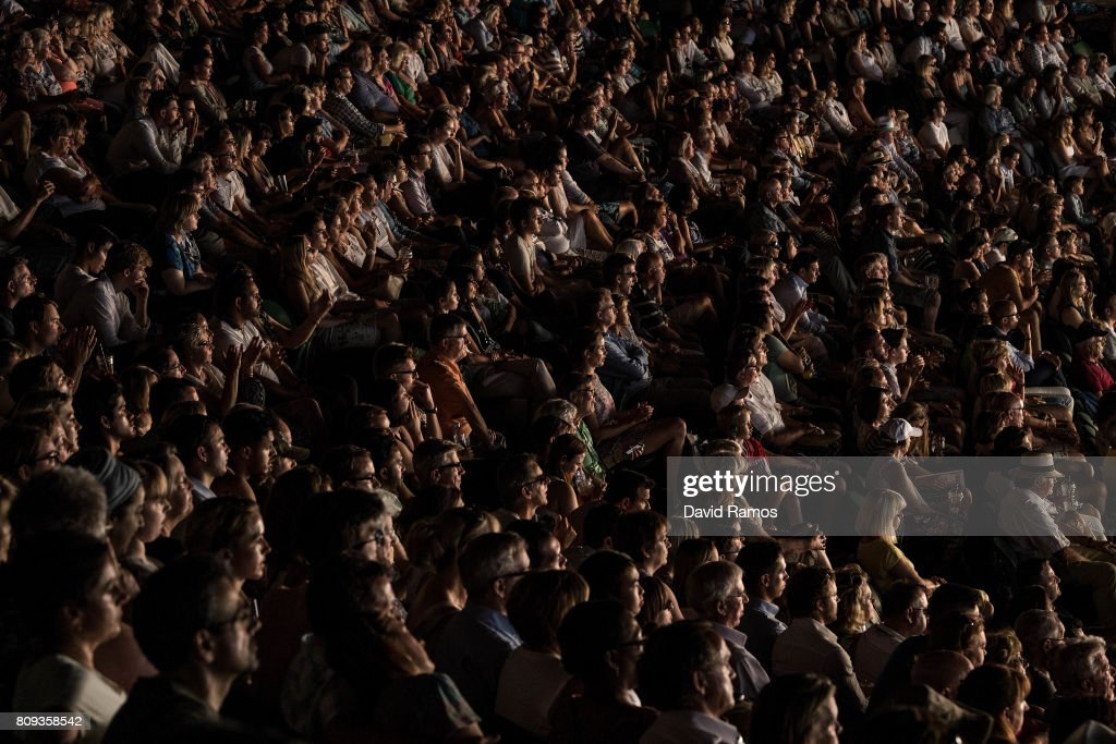 Spectators follow the action from the stand during the match between Rafa Nadal of Spain and Donald Young of United States on day three of the Wimbledon Lawn Tennis Championships at the All England Lawn Tennis and Croquet Clubon July 4, 2017 in London, England.