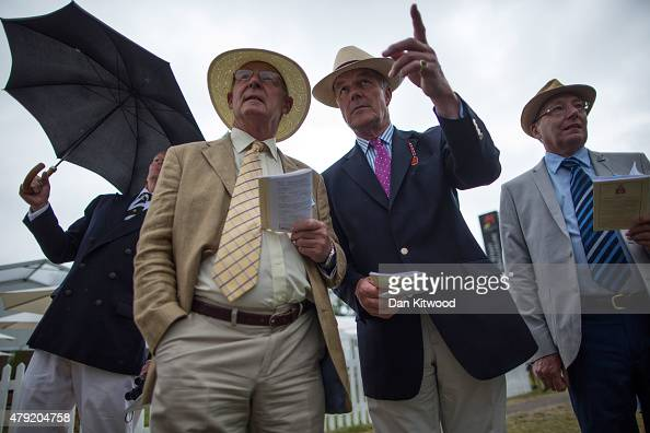 Spectators gather along the river bank tp watch racing on day two of the Henley Royal Regatta on July 2 2015 in HenleyonThames England This year is...
