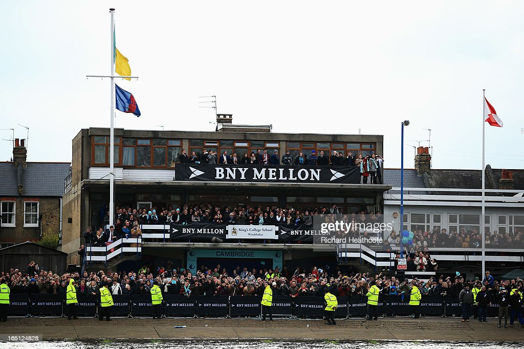 Spectators gather by the Cambridge boathouse prior to the BNY Mellon 159th Oxford versus Cambridge University Boat Race on The River Thames on March 31, 2013 in London, England.