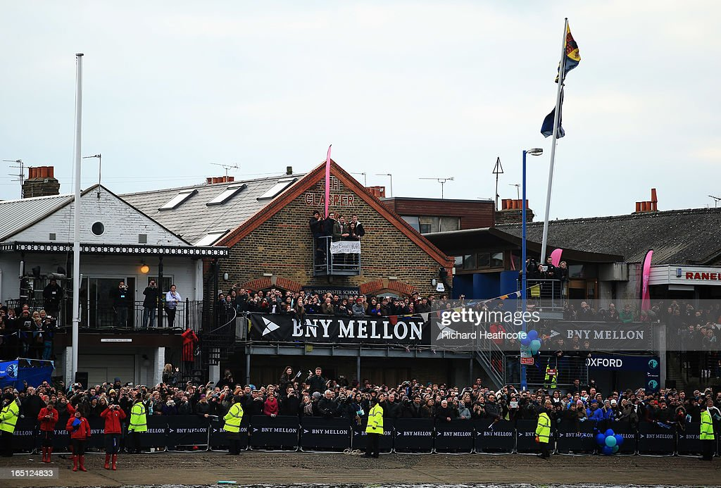Spectators gather by the Oxford boathouse prior to the BNY Mellon 159th Oxford versus Cambridge University Boat Race on The River Thames on March 31, 2013 in London, England.