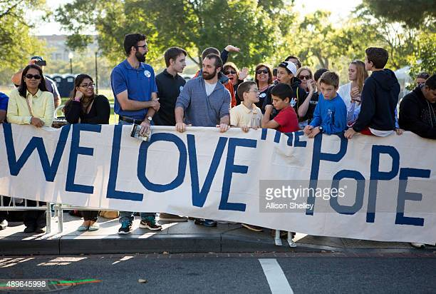 Spectators gather near the Ellipse to catch a glimpse of Pope Francis along the route his Popemobile will take near the White House September 23 2015...