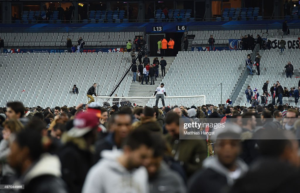 Spectators gather on the pitch of the Stade de France stadium following the International Friendly match between France and Germany at the Stade de...