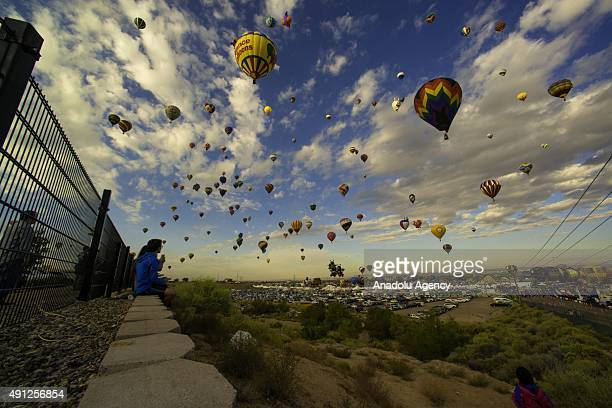Spectators gather outside of Balloon Fiesta Park to watch the balloons take off from Balloon Fiesta field during the Albuquerque International...
