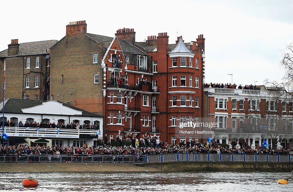 Spectators gather to watch the BNY Mellon 159th Oxford versus Cambridge University Boat Race on The River Thames on March 31, 2013 in London, England.