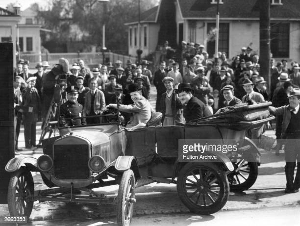 Spectators gather to watch the filming of 'County Hospital' on location in Los Angeles In the foreground are the Hal Roach comedians and stars of the...