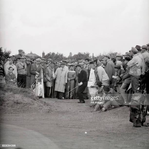 Spectators get a close up of America's Arnold Palmer as he chips his second shot onto the green at the fourth on the Royal Birkdale course