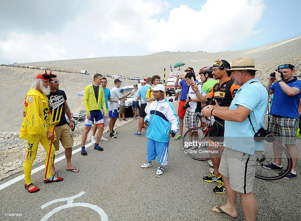 Spectators have their pictures taken with the Tour De France Devil during stage fifteen of the 2013 Tour de France, a 242.5KM road stage from Givors to Mont Ventoux, on July 14, 2013 on Mont Ventoux, France.