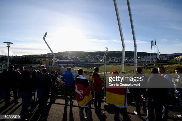 Spectators having no tickets proceed to a hill above the stadium to watch the FIFA 2014 World Cup Qualifier match between Faeroe Islands and Germany...