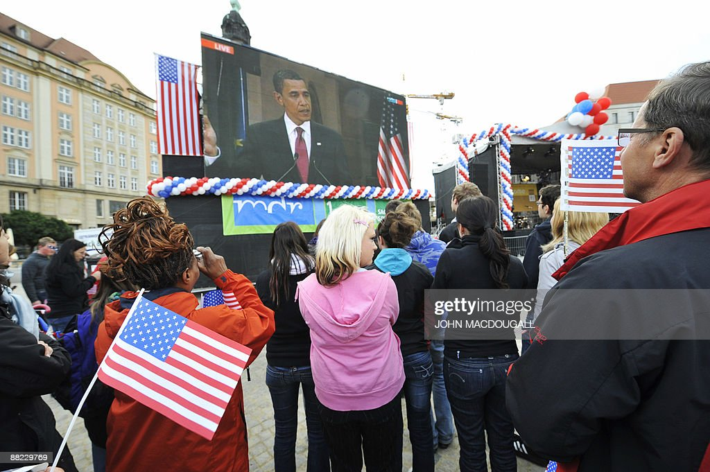 Spectators hold up US flags as they attend the public viewing of US President <a gi-track='captionPersonalityLinkClicked' href=/galleries/search?phrase=Barack+Obama&family=editorial&specificpeople=203260 ng-click='$event.stopPropagation()'>Barack Obama</a>'s speech in the eastern German city of Dresden on June 5, 2009. After policy talks and a news conference in Dresden, Obama and German Chancellor Angela Merkel are due to travel to Buchenwald, the former Nazi concentration camp where more than 56,000 prisoners died in horrendous conditions. Obama today swaps the political heat of the Middle East for a solemn two-day mission of World War II remembrance, and a fresh round of transatlantic diplomacy.