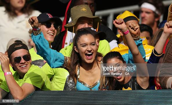 Spectators in dress up in the crowd cheer as David Warner hits a six during game three of the One Day International series between Australia and New...