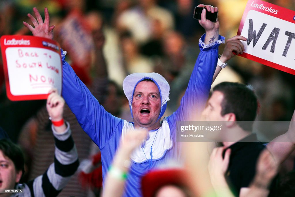 Spectators in fancy dress enjoy the atmosphere during day eleven of the 2013 Ladbrokes.com World Darts Championship at the Alexandra Palace on December 27, 2012 in London, England.