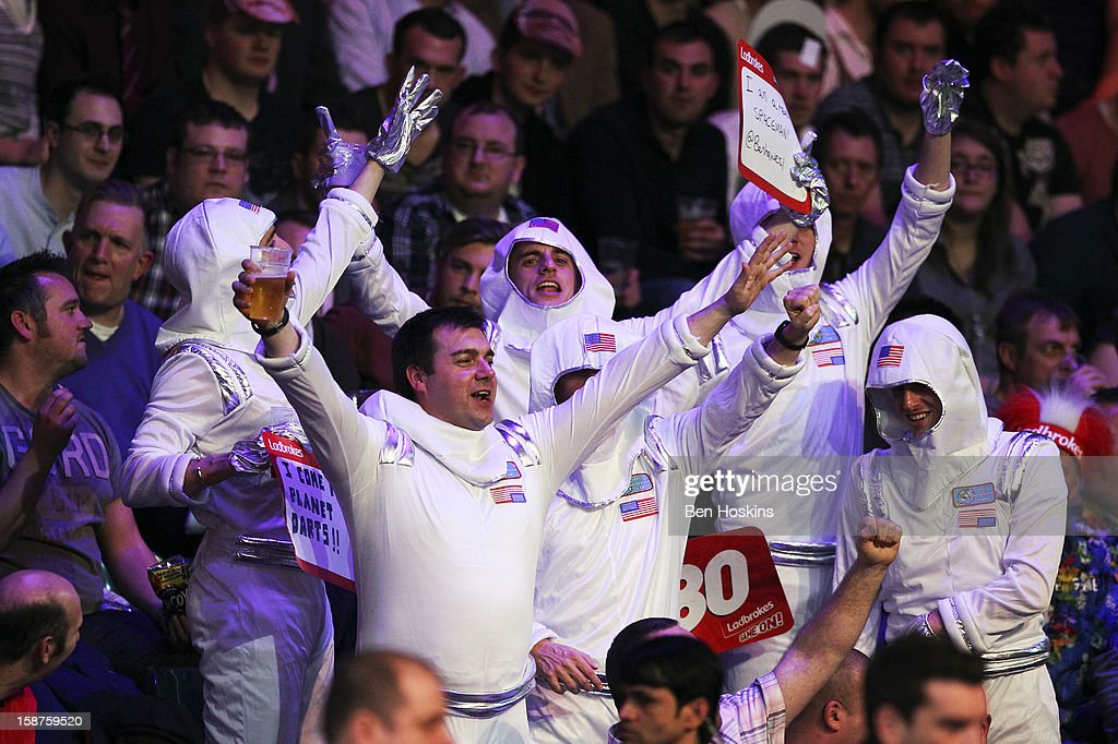 Spectators in fancy dress enjoy the atmosphere during eleven of the 2013 Ladbrokes.com World Darts Championship at the Alexandra Palace on December 27, 2012 in London, England.