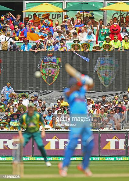 Spectators in fancy dress including Elmo and Gumby watch the match from the crowd during the One Day International match between Australia and India...