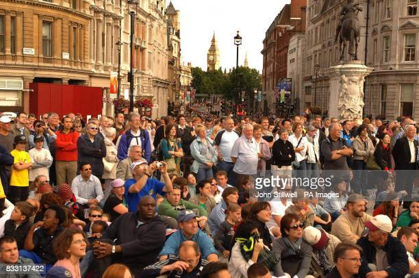 Spectators in London's Trafalgar Square gather to see the opening ceremony of the Tour de France which starts in London with the prologue tomorrow
