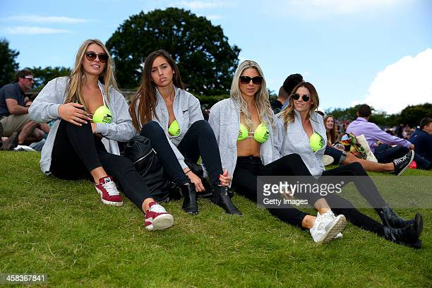 Spectators in Slazenger bikinis look on from Murray Mound during day six of the Wimbledon Lawn Tennis Championships at the All England Lawn Tennis...