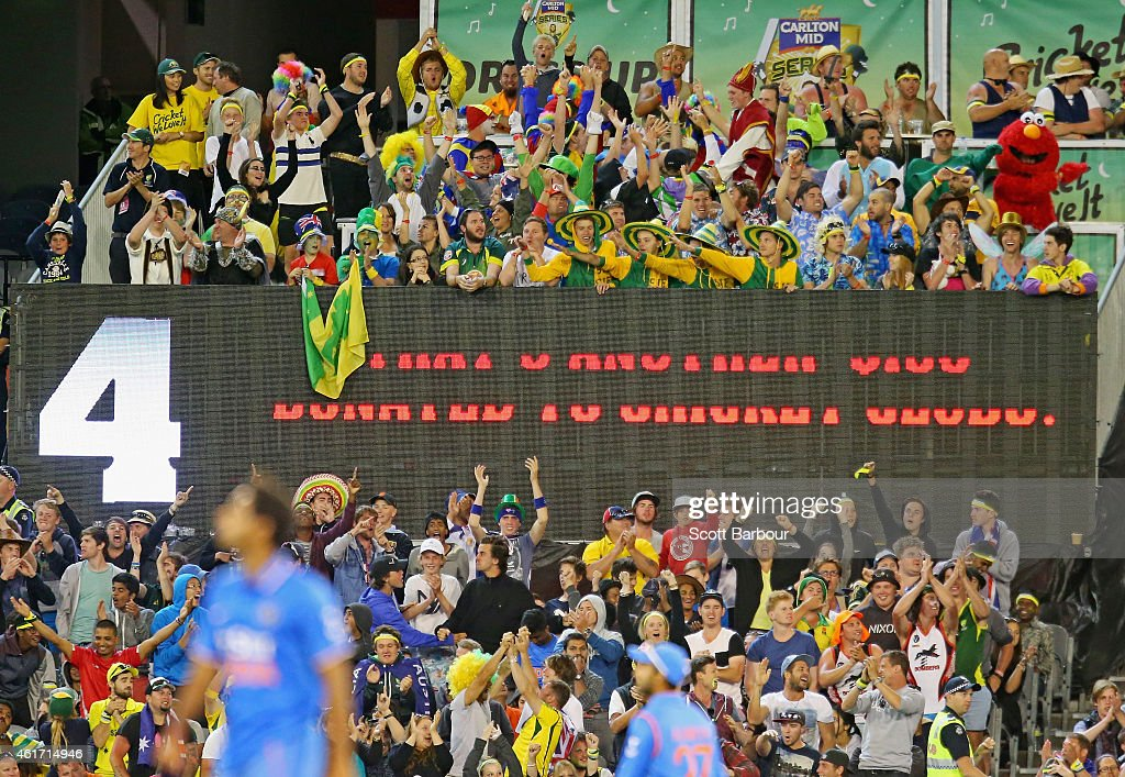 Spectators in the crowd wearing fancy dress including Elmo and Gumby celebrate as Australia hit the winning runs to win the One Day International...