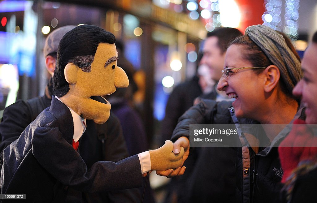Spectators interact with a puppet while waiting for the results of the 2012 Presidential election on November 6, 2012 in Rockefeller Center, New York City.