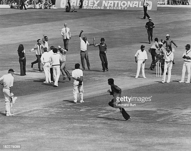 Spectators invade the pitch after England captain Ray Illingworth was dismissed for 0 during England's first innings on the third day of the third...
