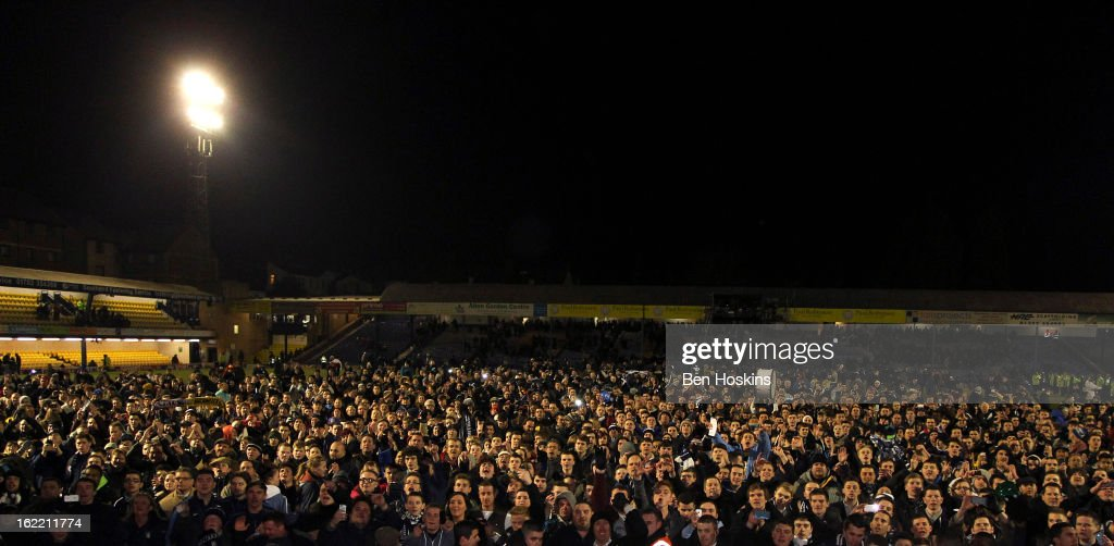 Spectators invade the pitch after the final whistle during the Johnstone's Paint Trophy Southern Section Final match between Southend United and Leyton Orient at the Roots Hall Stadium on February 20, 2013 in Southend, England.