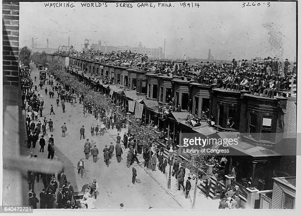 Spectators jam the roofs of rowhouses across from Philadelphia's Shibe Park in order to watch the 1914 World Series The Philadelphia Athletics played...