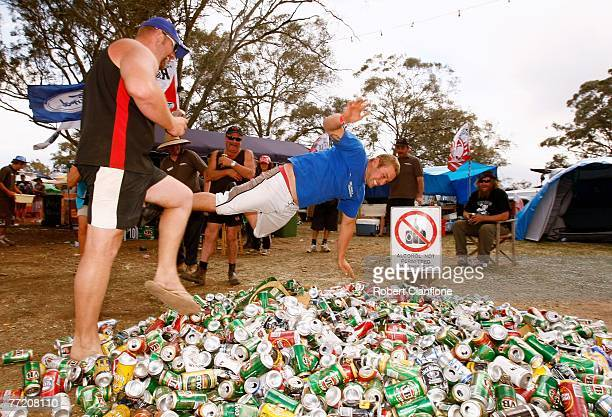 Spectators jump onto a pile of empty beer cans in the campgrounds prior to the top ten shootout for the Bathurst 1000 which is round ten of the V8...