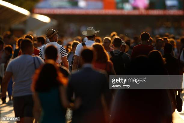 Spectators leave the court following play on day five of the 2017 French Open at Roland Garros on June 1 2017 in Paris France
