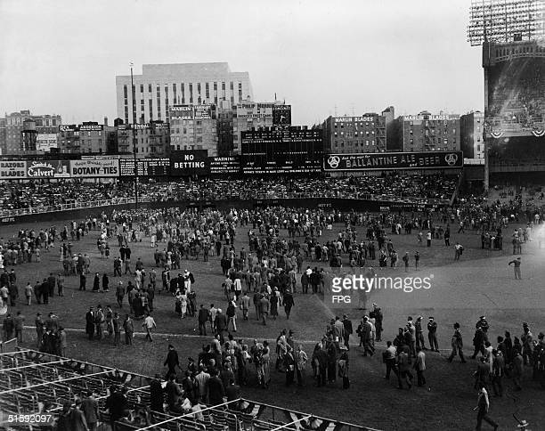 Spectators leave Yankee Stadium after the first game of the World Series following a bottom of the ninth inning home run from Tommy Henrich which won...