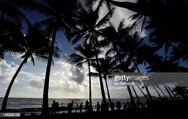 Spectators line the beach to view the total solar eclipse on November 14 2012 in Palm Cove Australia Thousands of eclipsewatchers have gathered in...