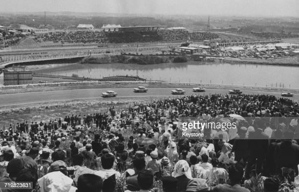 Spectators line the circuit to watch the race during the first Japanese Grand Prix for sports cars which was won by Peter Warr on 3 May 1963 at the...