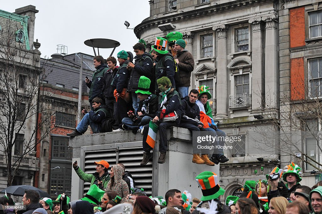 Spectators line the street to watch the St Patrick's Day parade on March 17, 2013 in Dublin, Ireland. More than 100 parades are being held across Ireland to mark St Patrick's Day, the feast day of the patron saint of Ireland, with up to 650,000 spectators expected to attend the parade in Dublin. Ireland has high hopes that the festivities will bring a much-needed boost to the economy.er caption here on March 17, 2013 in Dublin, Ireland.