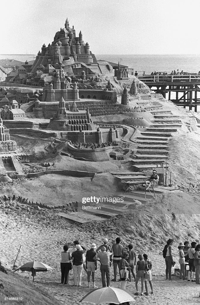 Spectators look at Sleeping Beauty's Castle a sandcastle rising 40 feet above the shores of the Pacific Ocean staking claim to the title of 'World's...