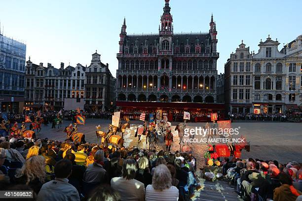 Spectators look at the 'Ommegang Oppidi Bruxellensis' historical parade at the Grand Place of Brussels on July 1 2014 AFP PHOTO / BELGA / NICOLAS...