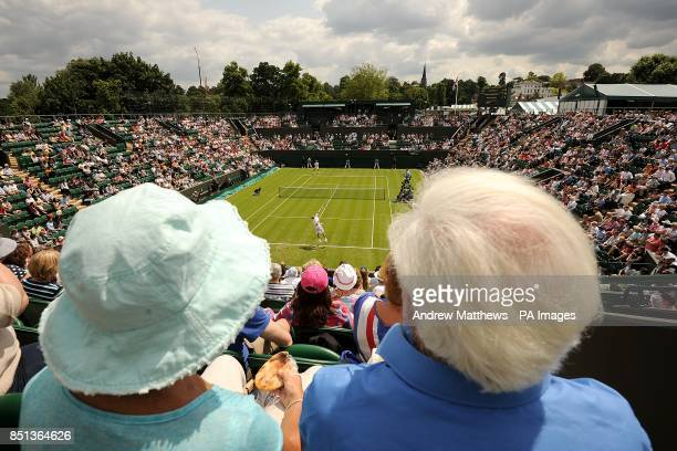 Spectators look on as Germany's Tommy Haas serves against Russia's Dmitry Tursunov