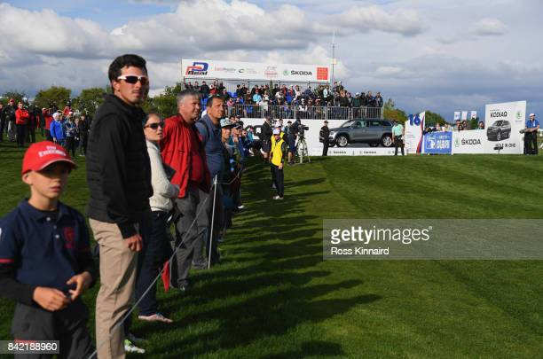Spectators look on as Haydn Porteous of South Africa tees off on the 16th hole during the final round on day four of the DD REAL Czech Masters at...