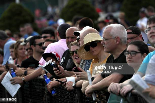 Spectators look on as live horse racing takes place at Suffolk Downs in East Boston on Jul 8 2017 It was one of six days on which the track will host...