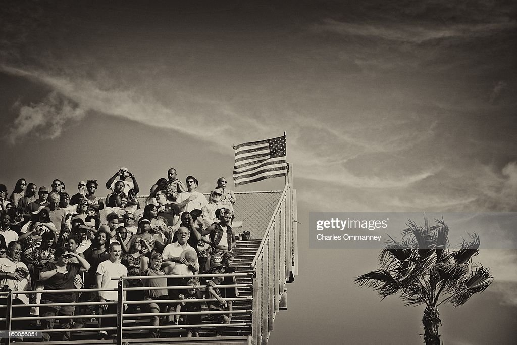 Spectators look on as U.S. President Barack Obama speaks during a campaign rally at the Delray Beach Tennis Center on October 23, 2012 in Delray Beach, Florida. Obama continues to campaign across the U.S. in the run-up to the November 6, presidential election.