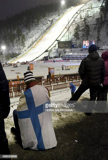 Spectators look on at the start of Ski Jumping Large Hill at the FIS Ruka Nordic 2015 in Kuusamo Northern Finland on November 28 2015 Ski jumping...