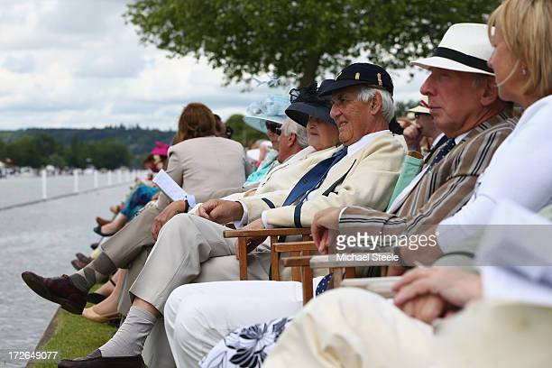 Spectators look on from the members enclosure during day two of the Hnley Royal Regatta on July 4 2013 in HenleyonThames England