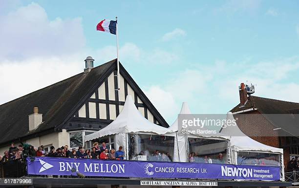 Spectators look on from the Mortlake boat house at the finish of The Cancer Research UK Boat Races on March 27 2016 in London Englandon March 27 2016...