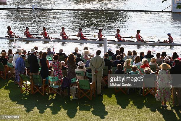 Spectators look on from the stewards enclosure as an eights crew passes during day two of the Hnley Royal Regatta on July 4 2013 in HenleyonThames...