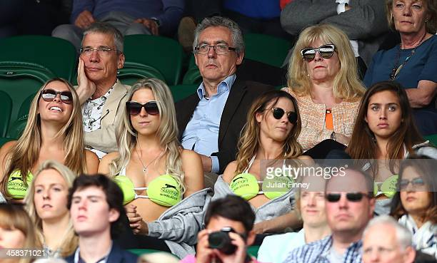 Spectators look on in centre court on day six of the Wimbledon Lawn Tennis Championships at the All England Lawn Tennis and Croquet Club on July 2...