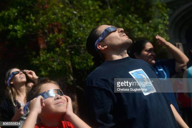 Spectators look skyward during the partial solar eclipse at peak time on August 21 2017 in Los Angeles California