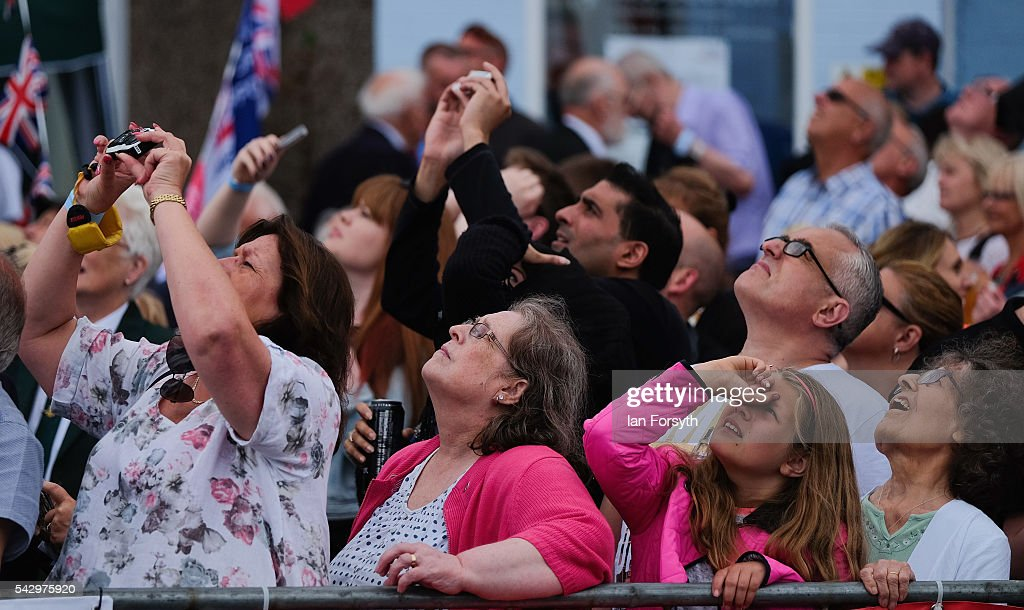 Spectators look up at an air display during the Armed Forces Day National Event on June 25, 2016 in Cleethorpes, England. Armed Forces Day is an annual event that gives an opportunity for the country to show its support for the men and women in the British Armed Forces.