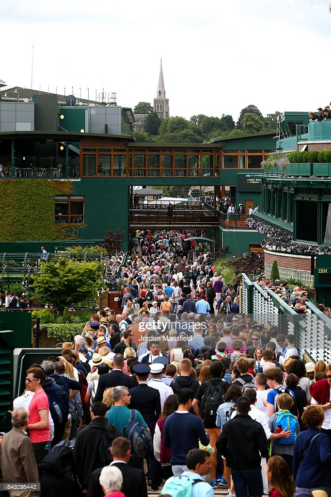 Spectators make their way into the ground ahead of the start of day one of the Wimbledon Lawn Tennis Championships at the All England Lawn Tennis and Croquet Club on June 26, 2016 in London, England.