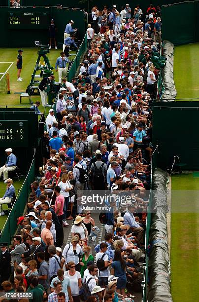 Spectators make their way round the outside courts during day seven of the Wimbledon Lawn Tennis Championships at the All England Lawn Tennis and...